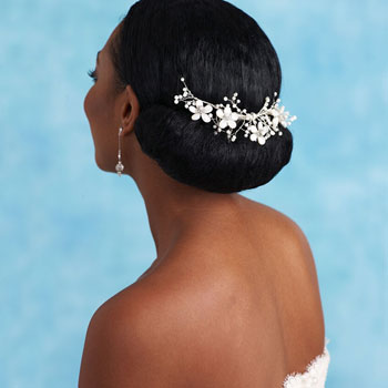 Best wedding Hairstyle with Tiara fixed at the back for Black Women