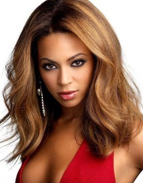Cute Medium hairstyle with Blonde Highlights on loose waves Black Women