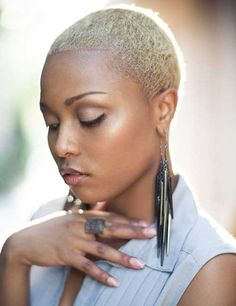 Inspiring short Bald white blonde haircut with jewelry African American