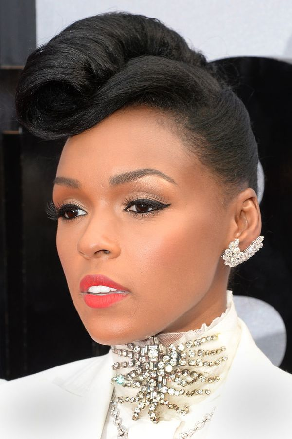 Interesting Natural Wedding hairstyle with turn up at the crown for black Women