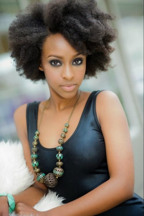 Adorable short haircut long face layered African American