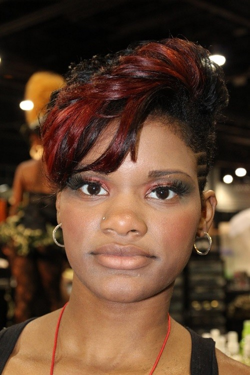 Captivating short Mohawk haircut with highlights African American at 30