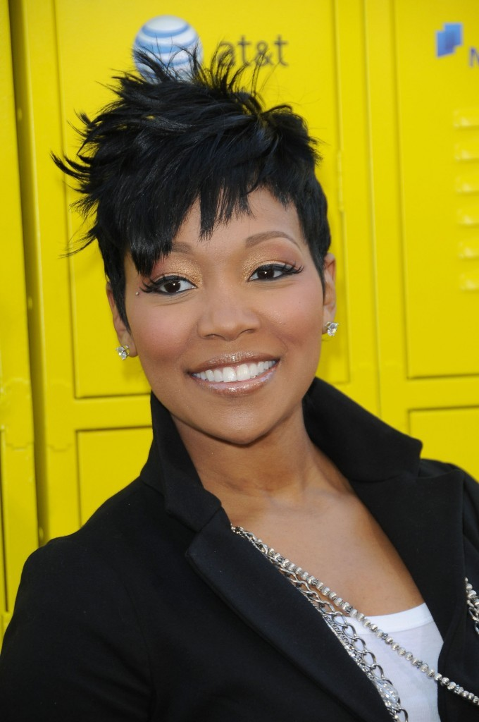 Eye catching short messy haircut with up do African American