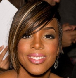 Short haircut straight with brown highlights African American