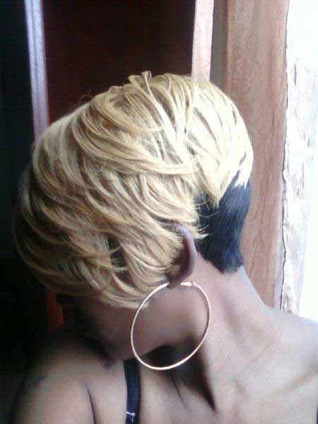 Short thick Blonde wavy haircut African American