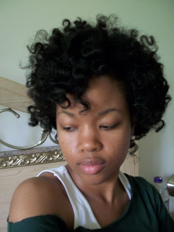 Natural Curly Haircut for Black Women With Round Face